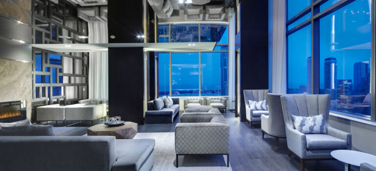 46th floor amenity space in condo in cool blues, grays with pale stone walls.