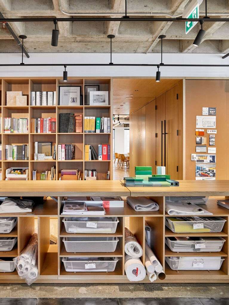 A long fixed table provides ample storage and a work top for this architectural firm.