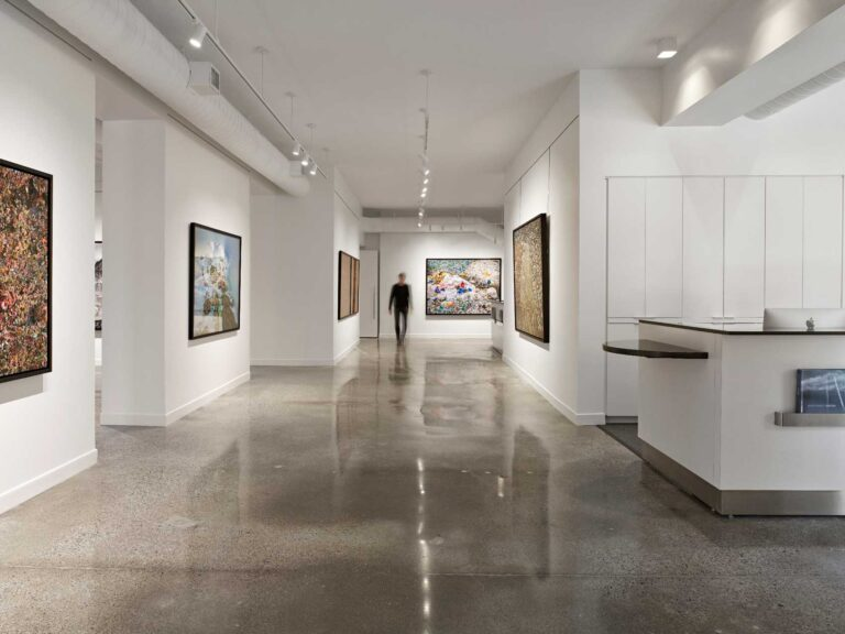 Vazt art gallery with white walls and polished concrete floor.