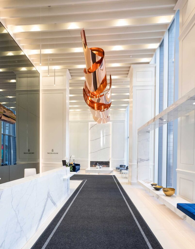 A twisting copper sculpture is suspended in the lobby of a Toronto condo.