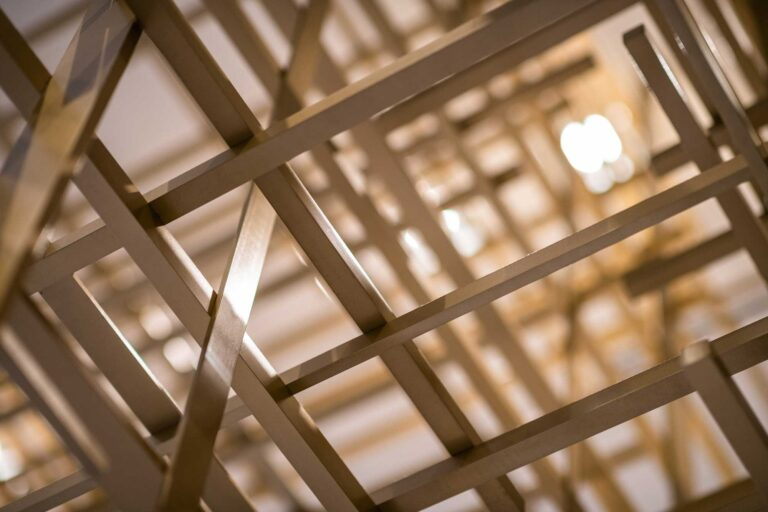 Detail view of several intersections of the cross hatched bars, making an artistic grid.