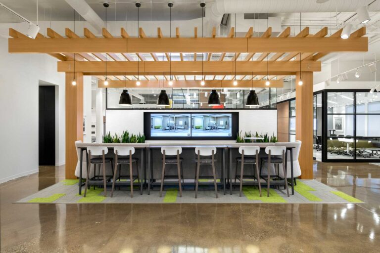 An indoor pergola demarcates a meeting area and creates an outdoor feel even in harsh prarie winters.