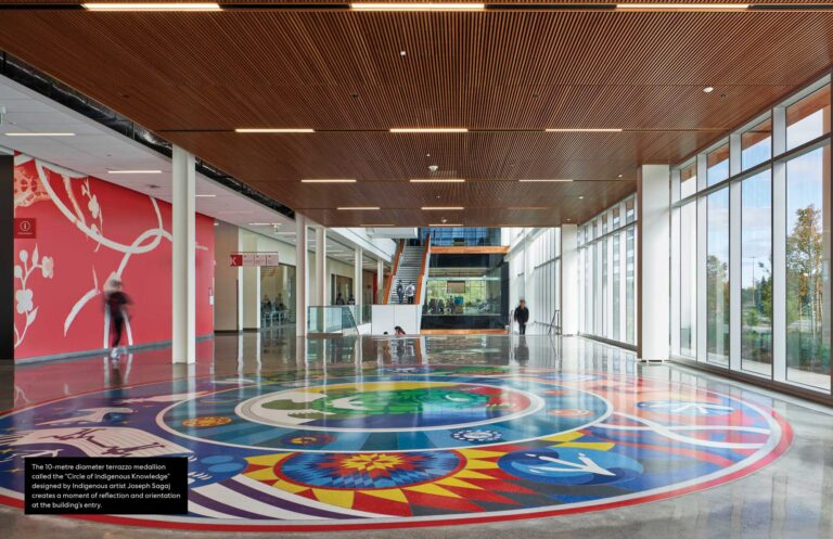 """A 10 meter terazzo medallion called """"Circle of Indigenous Knowledge"""" designed by Indigenous artist Joseph Sagaj creates a moment of reflection and orientation at the building"""