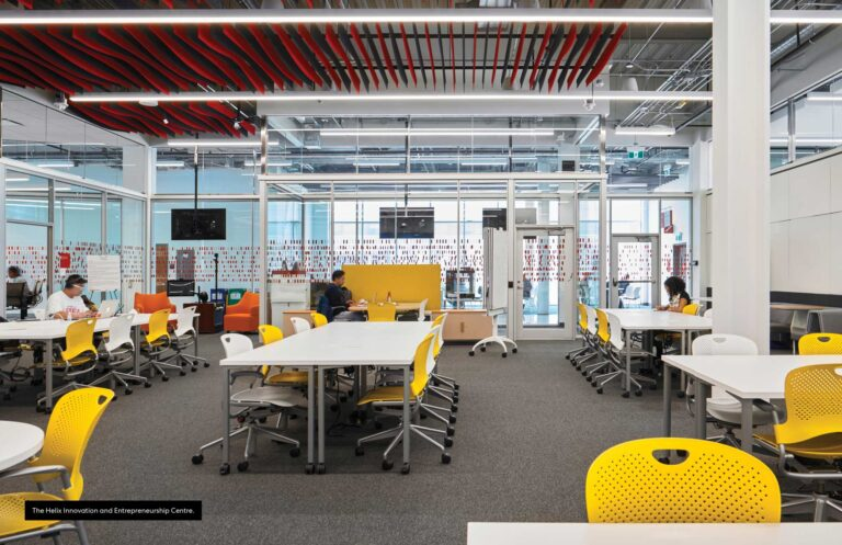 Yellow chairs contrast with the gray carpeting of a flexible study space at CITE Seneca.