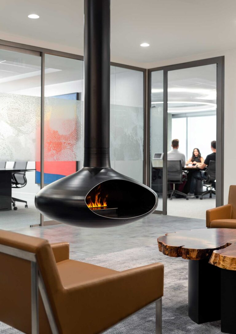A hanging fireplace demarcates a cozy meeting nook at the Cooperators Regina office.