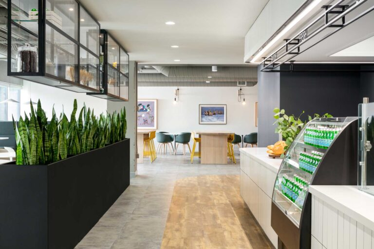 Employee cafe area with polished concrete floor and glass cabinets with company memoribilia.