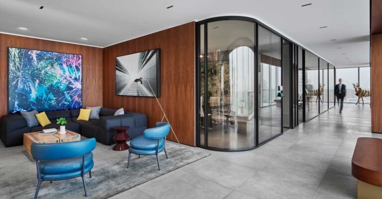 A seating area at First Gulf offices is lined with contemporary art and modern azure armchairs.