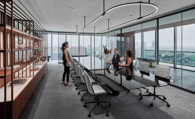 The main boardroom at First Gulf seats 14, with views of Toronto, and a deer sculpture by Robert Cram.