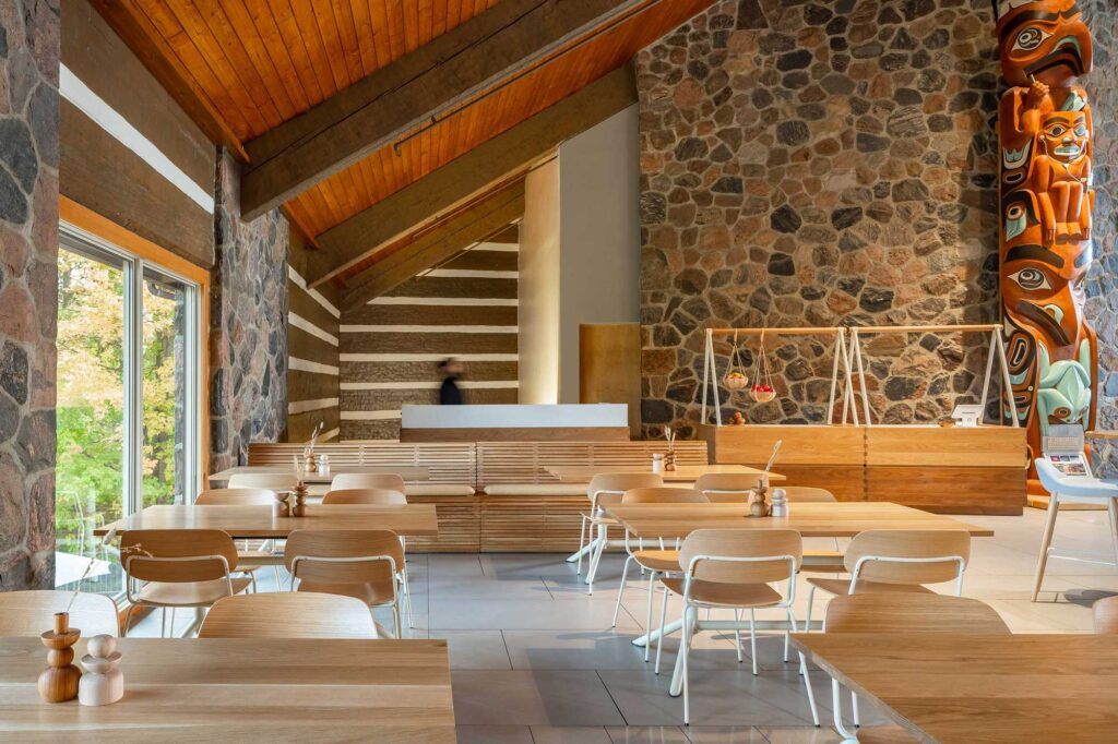 The cafe at the McMichael Canadian Art collection has several seating options with pale wood tables and white chairs.