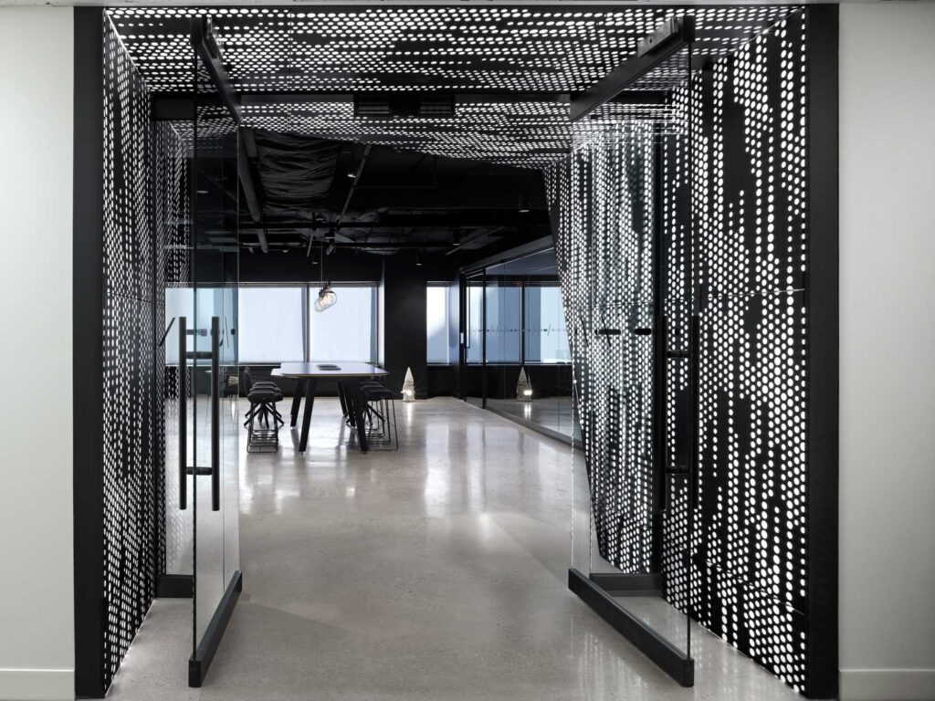 A perforated metal screen backlit in white sets the tone for stepping into the futuristic, phygital Smart City Sandbox.