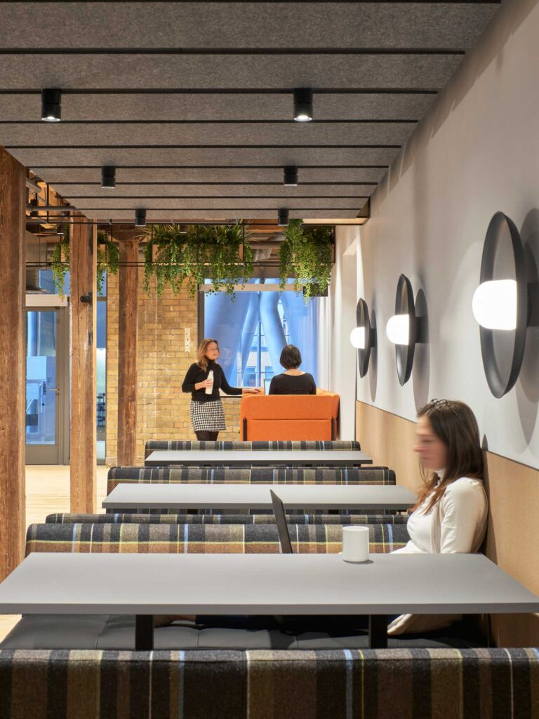 Low booths upholstered in plaid provide meeting and eating options at Sobeys Innovation Hub.