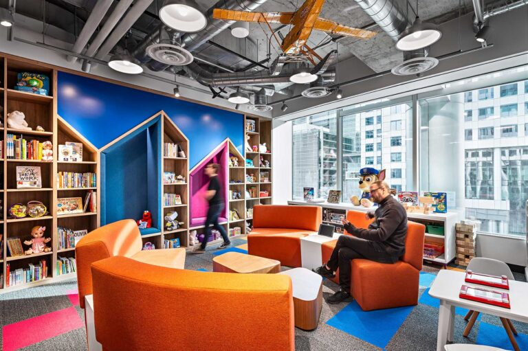 A space for ideas and brainstorming at Spin Master with seating, books, toys and games for staff.