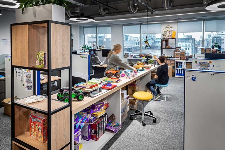 The toy development offices have a long table for current projects and brainstorming.