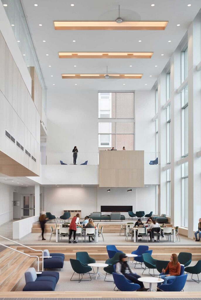 The forum at the Mulroney Institute has couches and chairs for meeting, tables and chairs and sofas.
