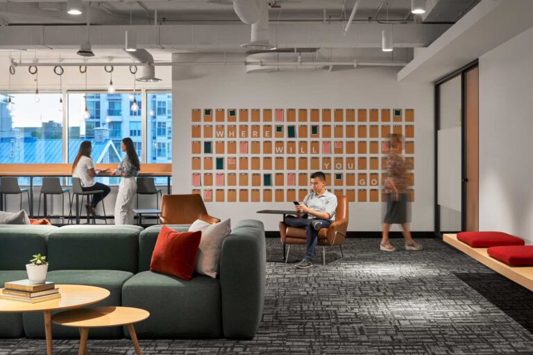 """A branded wall installation for staff notes and messages has the message """"Where will you go"""" in behind."""