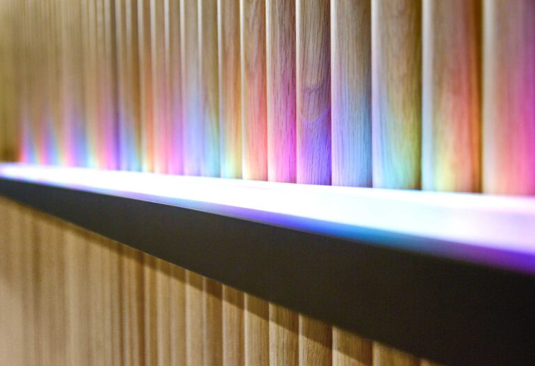 Detail of a tambour wall installation which can be lit in various colour schemes for special events or observances.