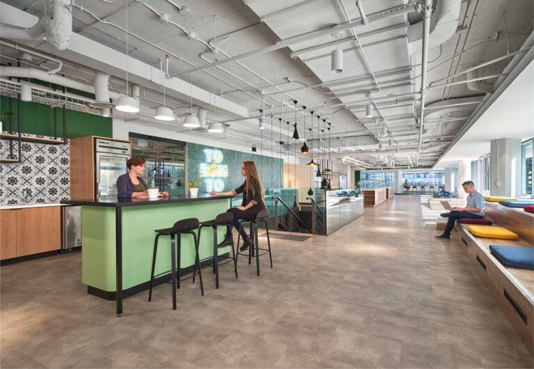 Hands free cafe space at Uber Toronto offices, with mint and black cafe space, and cushioned bench seating area.