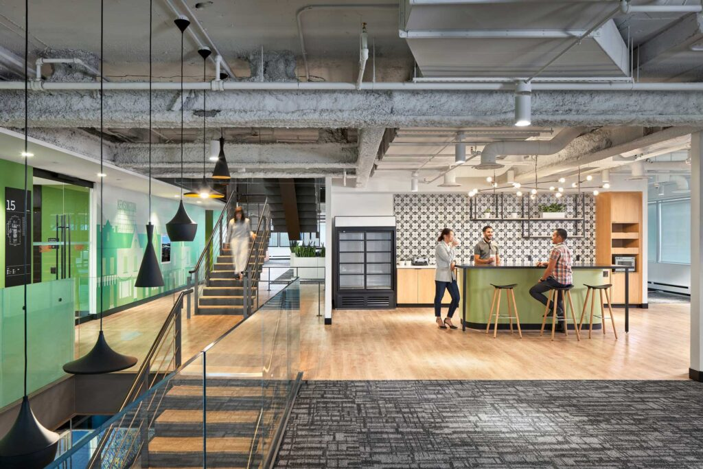 The hands free cafe space at Uber's office in Toronto is in a colour scheme of mint and black, with pale wood floors and black and white decorative tile.