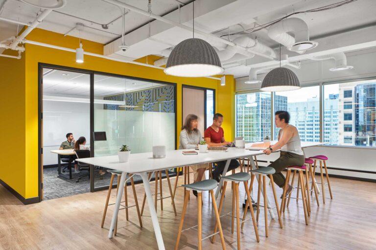 Staff meet at a high top table at Uber