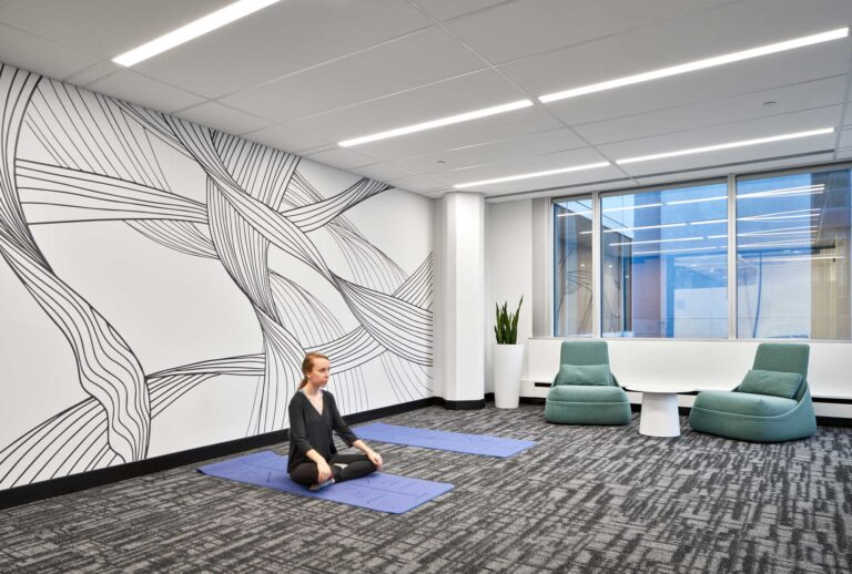 A woman sits in a meditation room at Uber