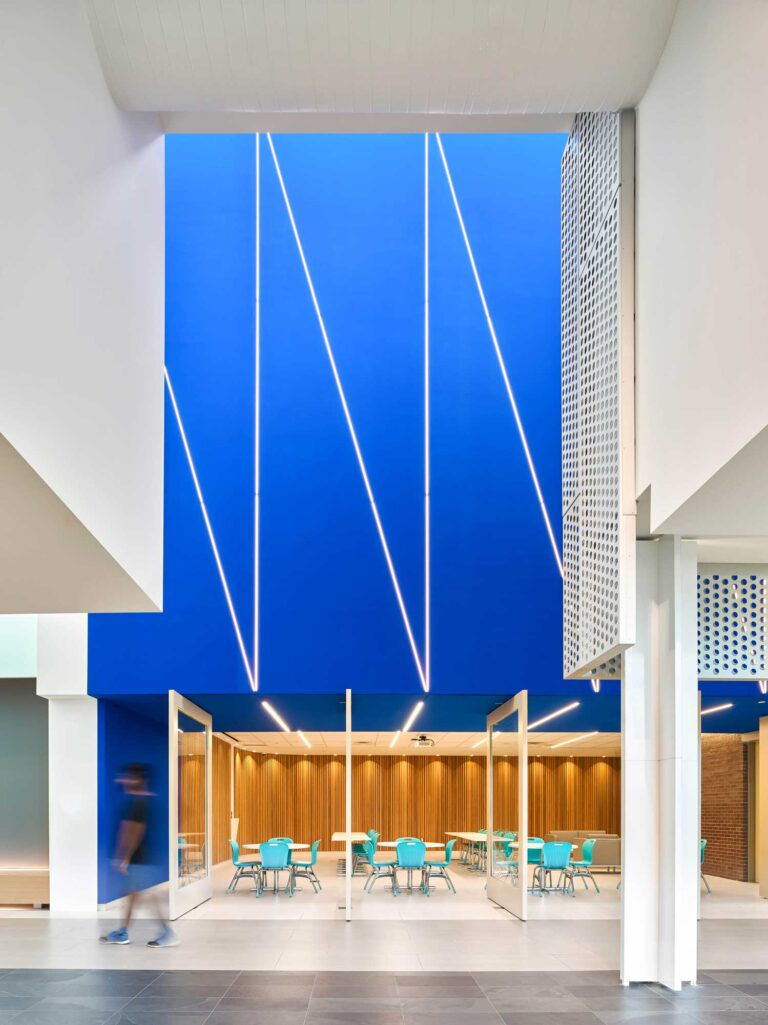 A cobalt coloured ceiling draws the eye and is an energizing flash of the college